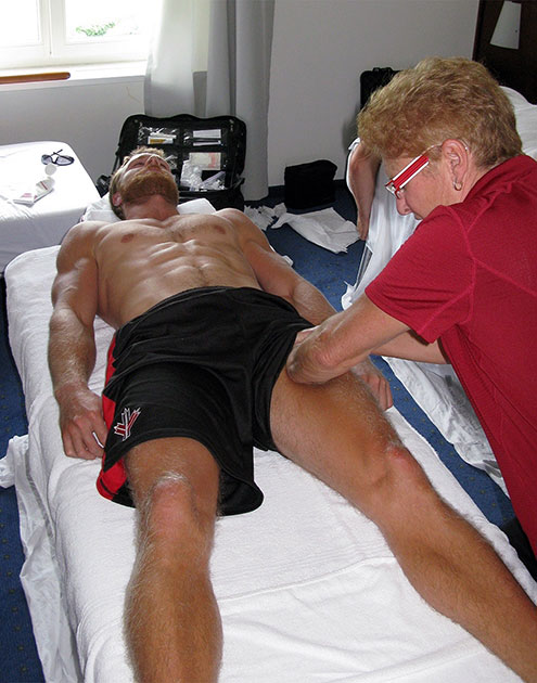 athlete preparing for performance with physiotherapy